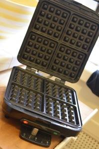 waffle iron preparing to preheat spray with oil