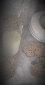late night by the light of the refrigerator.. cookies and milk