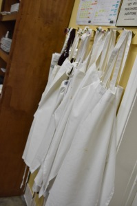 The students clean aprons